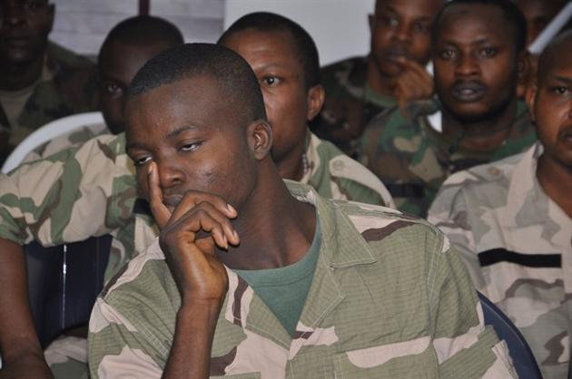 In this Thursday, Oct. 2, 2014 file photo, soldiers accused of refusing to fight in the country's northeastern Islamic uprising appear before a court martial in Abuja, Nigeria. On Wednesday Dec. 17, 2014, the court-martial sentenced 54 soldiers to death for mutiny, assault, cowardice and refusing to fight Islamic extremists, connected to the soldiers' refusal to deploy to recapture three towns seized by Nigeria's home-grown Boko Haram in August, according to the charge sheet. . (AP Photo/Olamikan Gbemiga FILE)