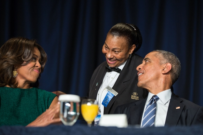 President Barack Obama and First Lady Michelle Obama interact with Hilton banquet server Kitty Casey during the National Prayer Breakfast at the Washington Hilton in Washington, D.C., Feb. 5, 2015. (Official White House Photo by Pete Souza)