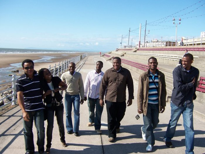 From Left to Right – Ezeocha Post's Chinedu Ezeocha (wearing shades), Eseosa Sowemimo, Akin Omoyoruba, Michael Amankwa, Ebitari Tekenah (of blessed memory), Chikelue Uwafili (in stripped T-Shirt and jacket), and Dilioha Igbo (far right). Blackpool, England. June 2008.